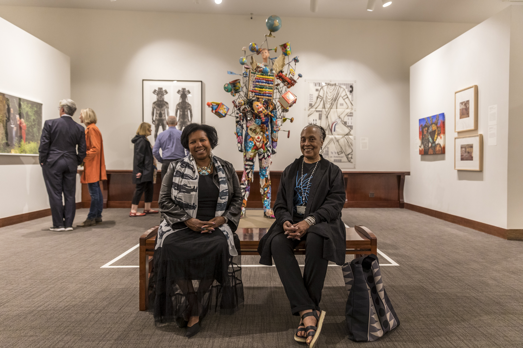 Two docents sitting in a gallery