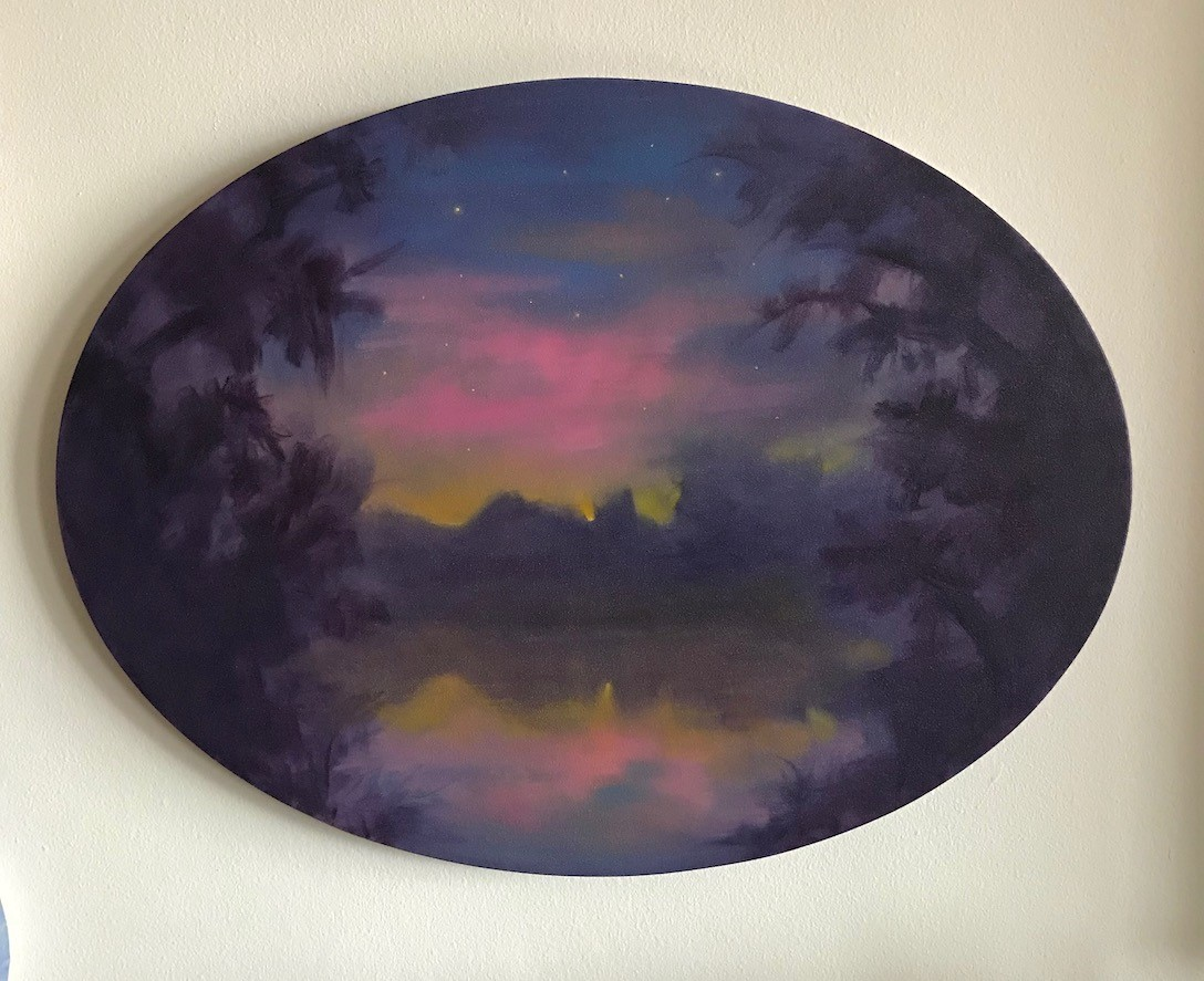 A landscape on an oval canvas painted by Joyce Korotkin.
