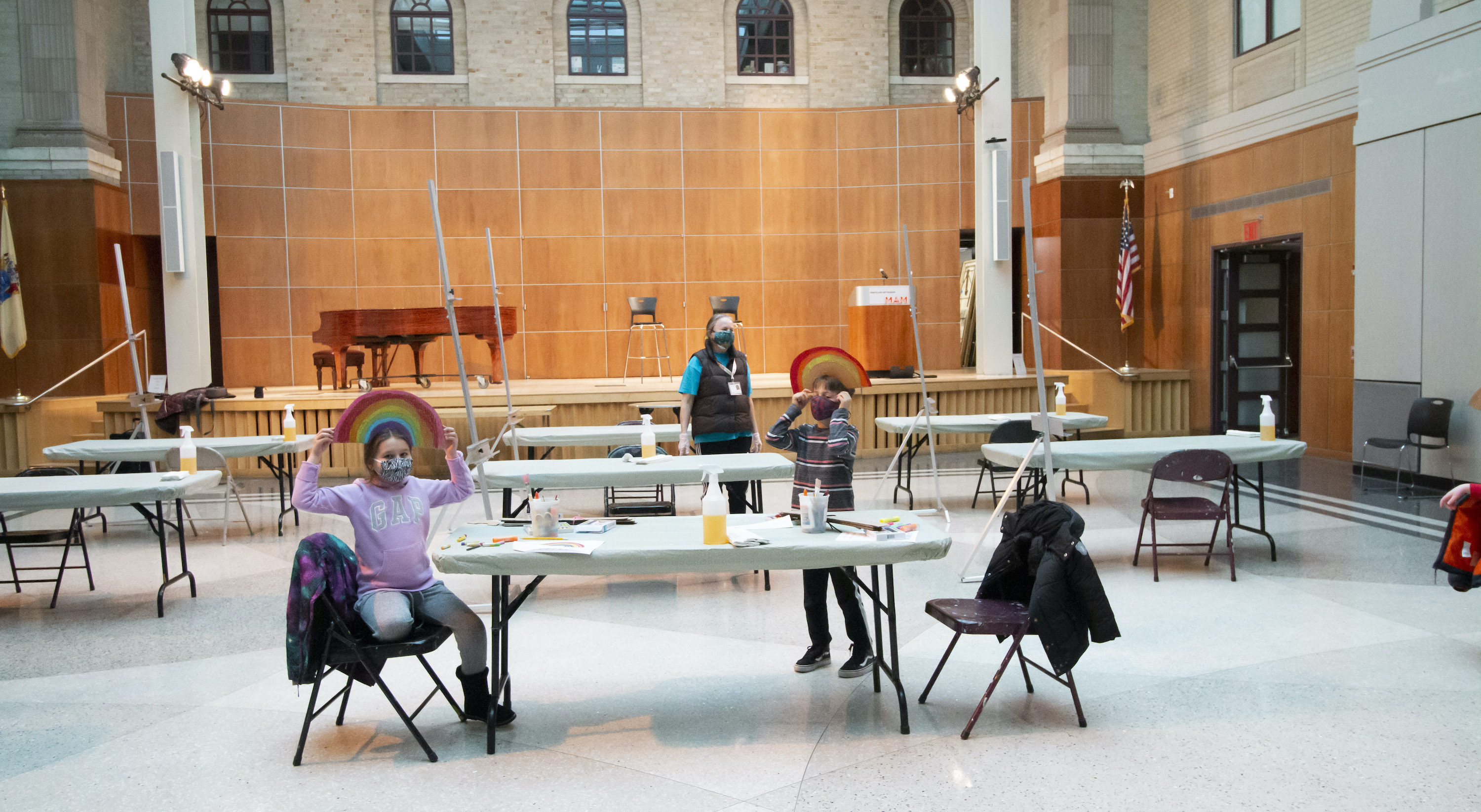 Young students working in Leir hall at their own tables in a socially distanced drawing class.
