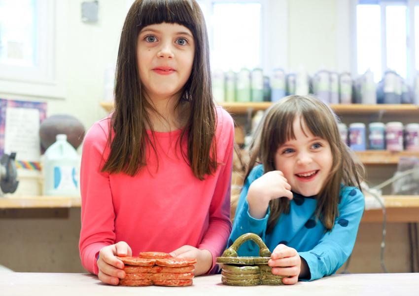 two young girls in a ceramic class