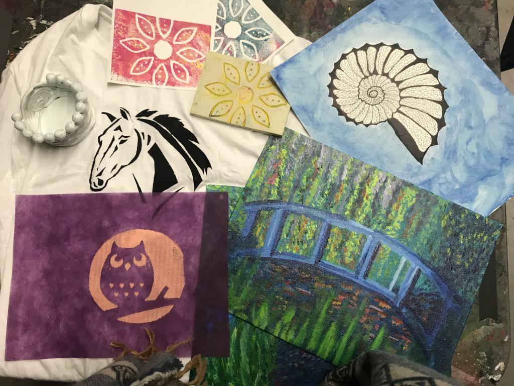 A scattering of art made in the Art for the Nonartists class.