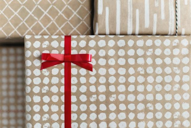 Handmade wrapping paper with white dots and other patterns on a kraft paper-like background.
