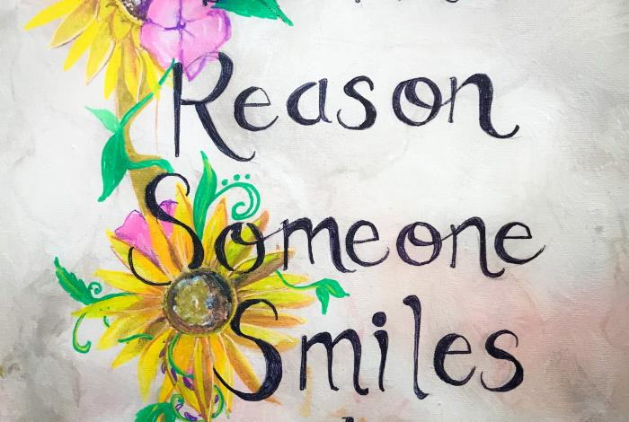 "a photo of an embellished quote as an example of what students can create in class. It reads ""be the reason someone smiled today."""