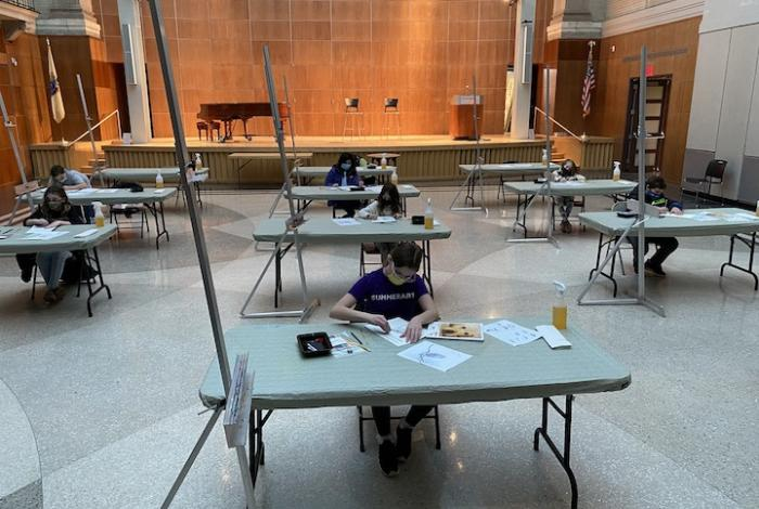 students working in lier hall at their own tables in a socially distanced drawing class.
